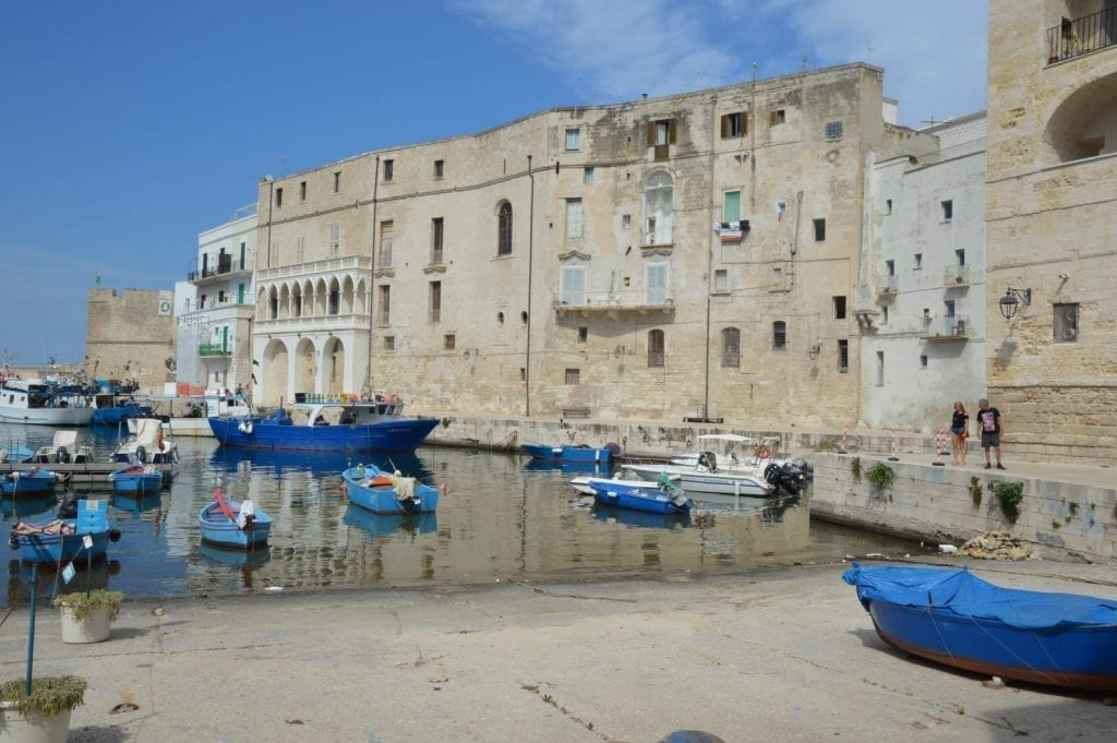 Monopoli Harbor with blue boats in Italy