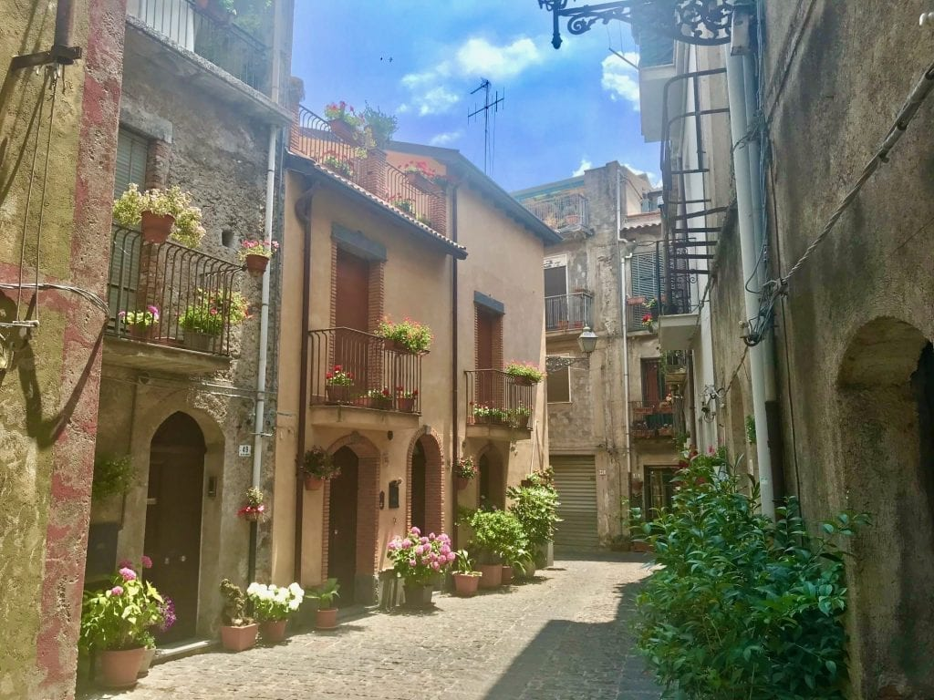 Small street in Randazzo Italy lined with stone buildings on both sides