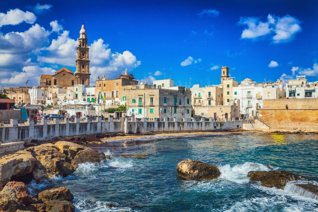 whitewashed town of monopoli italy as seen from across the water, one of the best villages in italy to visit