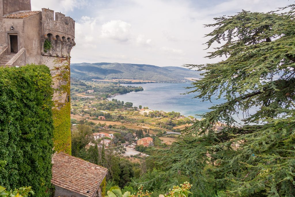 lake bracciano from above with castle turret in the left foreground