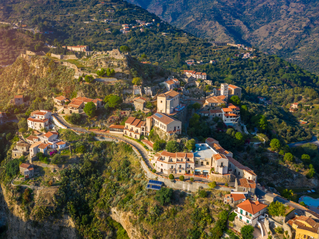 aerial view of savoca sicily surrounded by green hills
