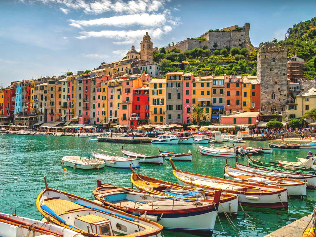 harbor of porto venere italy with boats in the foreground, one of the best small villages in italy