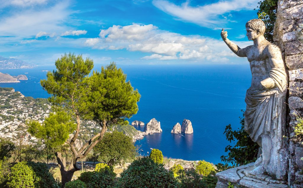 view of capri italy from above with a marble statue in the right foreground
