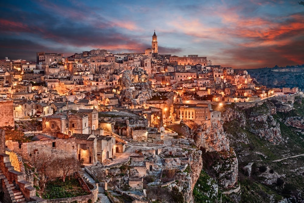 Matera at sunset with the lights in the city turned on, one of the prettiest small towns in Italy