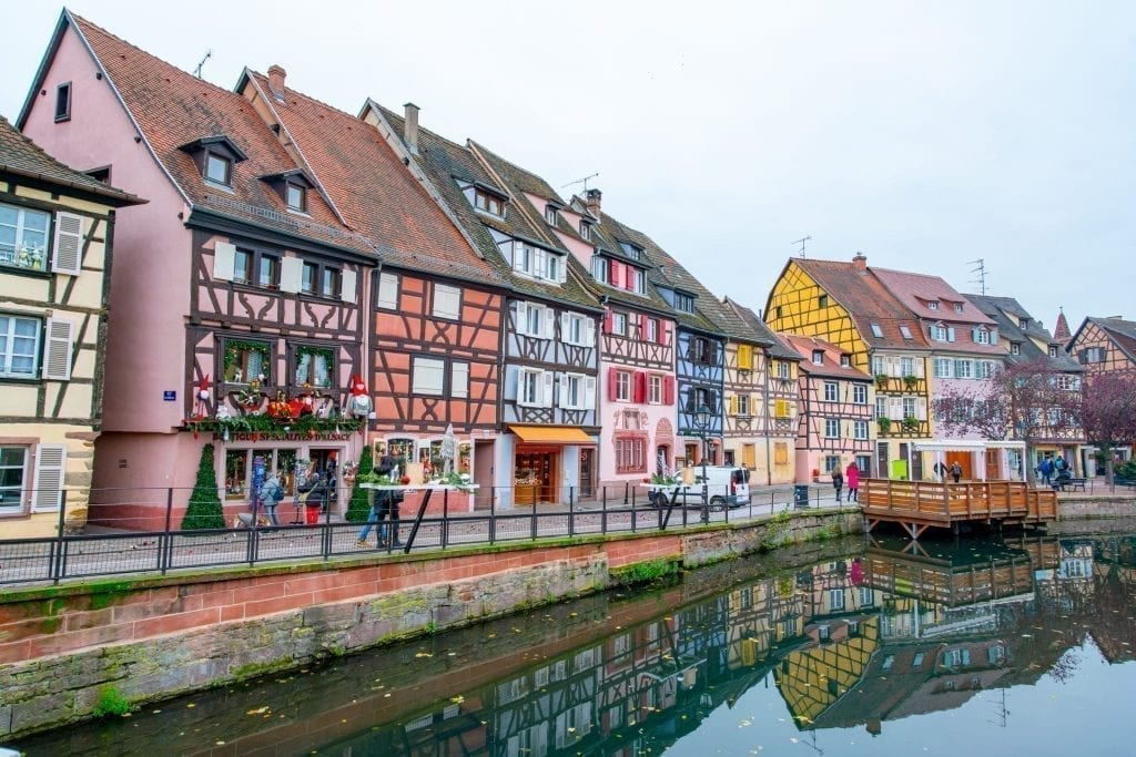 Colorful houses in Colmar France with a canal in the foregroud