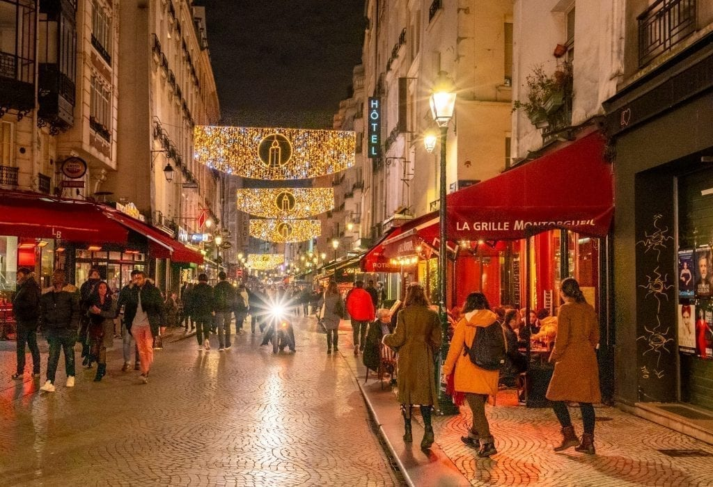 Rue Montorgueil with Christmas lights--a visit here definitely belongs on your list of what to do in Paris at night