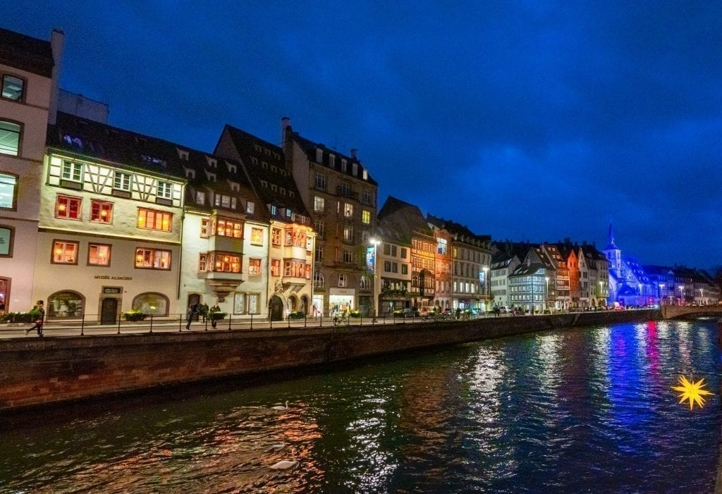 Strasbourg canal at blue hour with lights lit up on the buildings