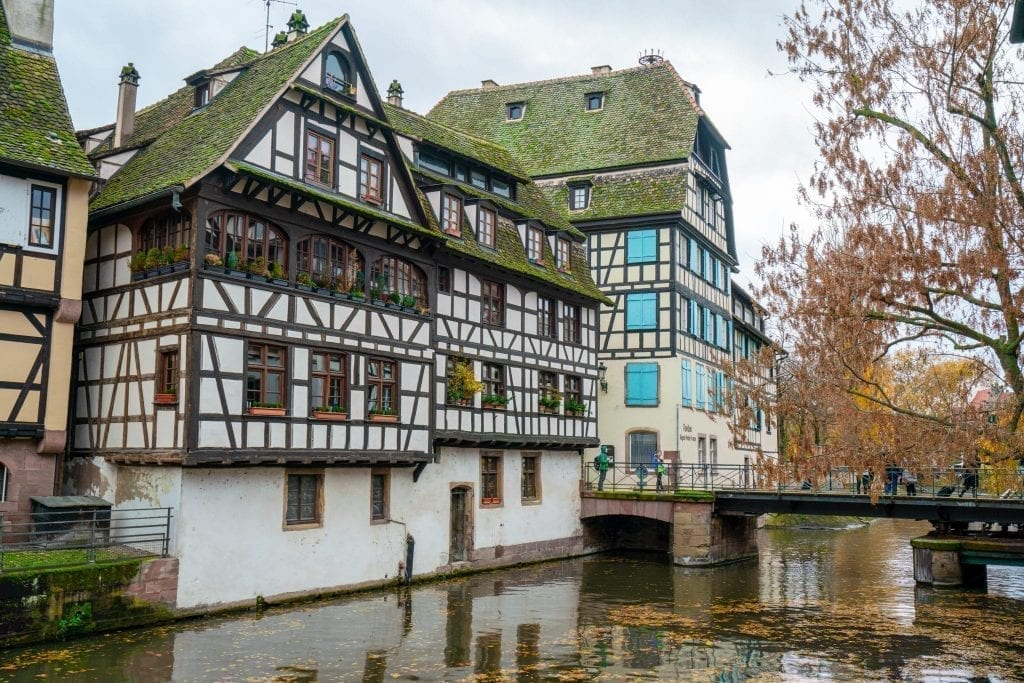 La Petite France neighborhood in Strasbourg France with a canal in the foreground