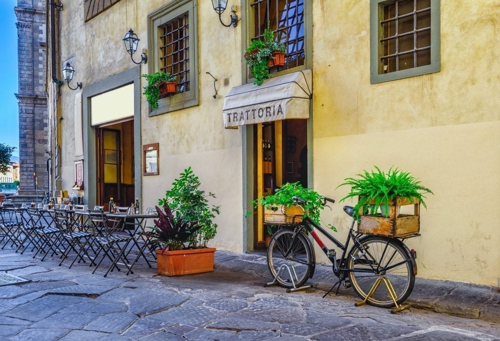 Exterior of a trattoria, a great casual place to explore food in Florence, with a bike parked outside