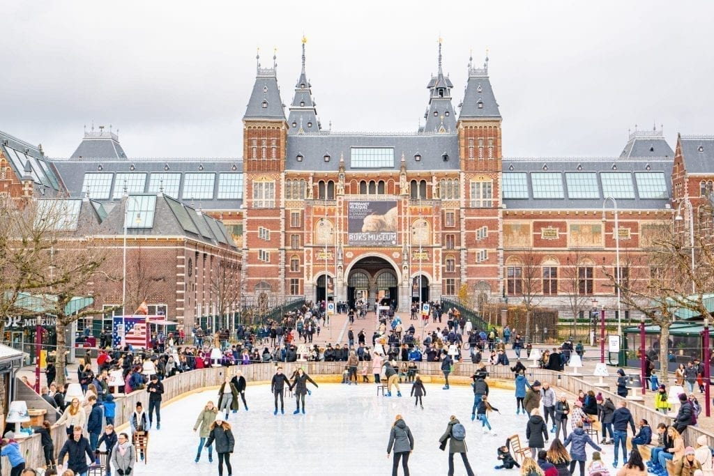 Ice skating rink in Amsterdam with Rijkmuseum visible behind it
