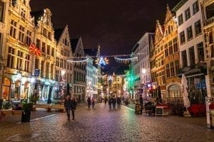 travelers exploring the decorated streets of antwerp belgium at night decorated with christmas belgium in winter lights