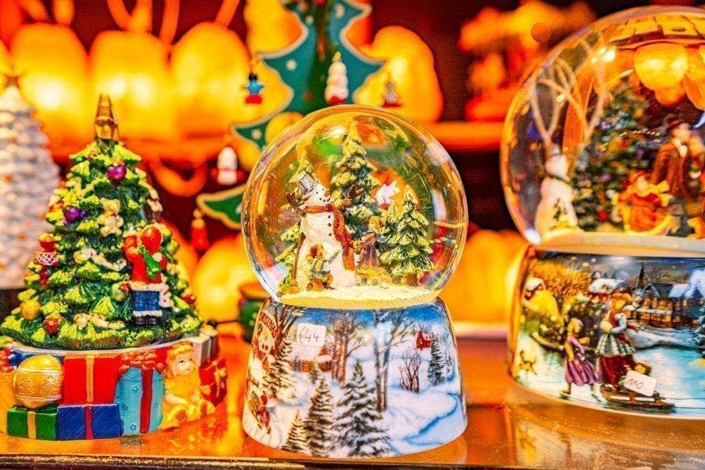 snow globes for sale at one of the christmas markets in belgium december