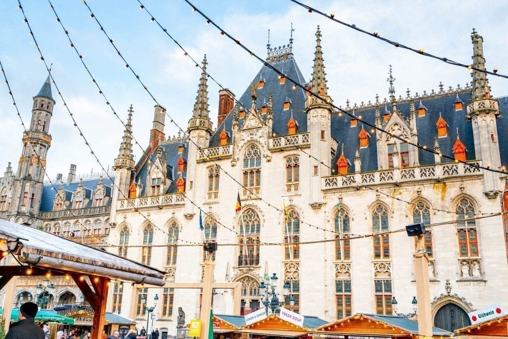 Bruges Markt Building with Christmas lights in the foreground. Don't miss exploring the markt as part of your one day Bruges itinerary