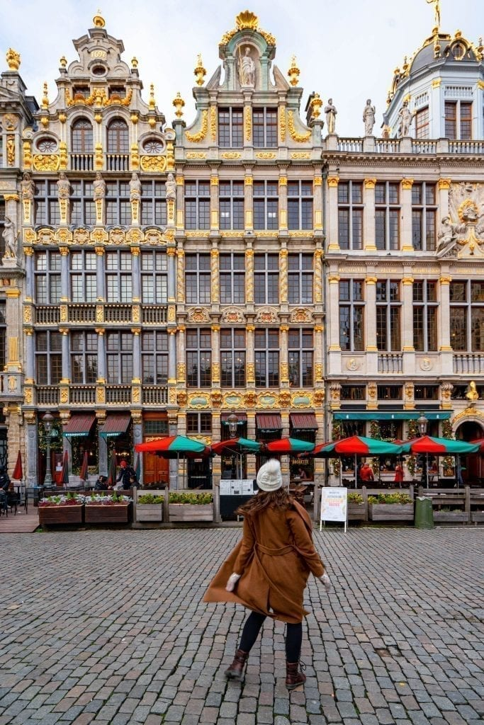 kate storm spinning in a brown coat in grand place belgium