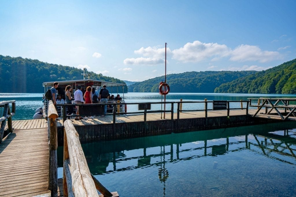 Dock at Lake Kozjak in Plitvice Lakes National Park showing visitors boarding the ferry