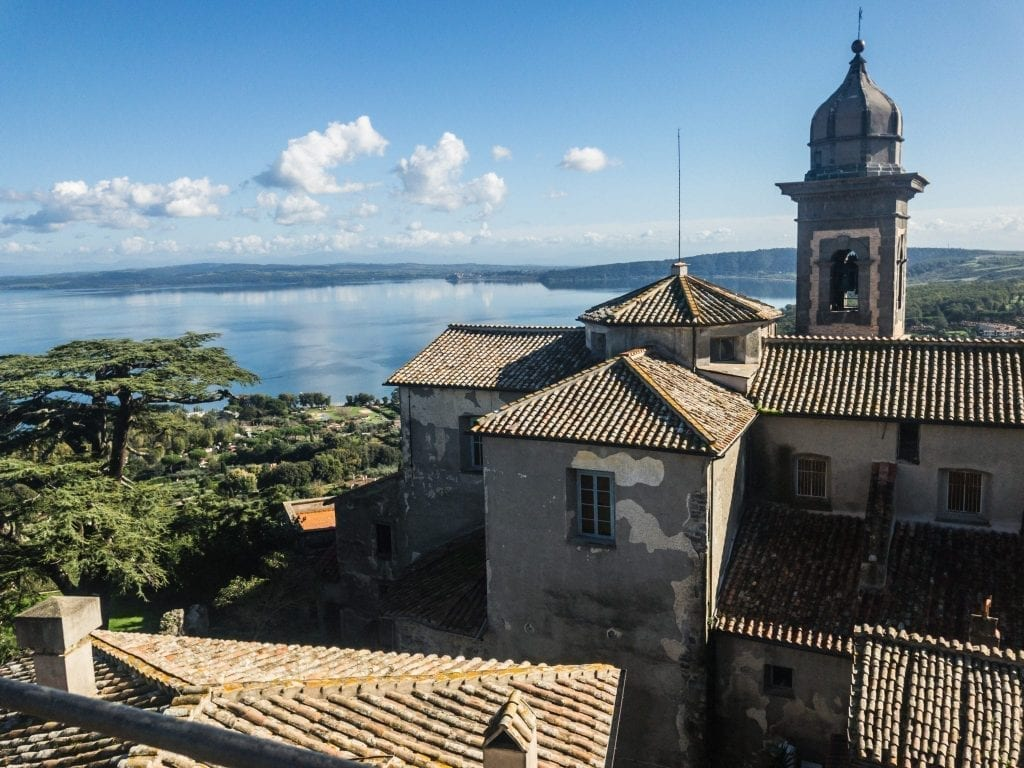 View of Bracciano from the castle with the town in the foreground and lake in the background. Bracciano is one of the best Rome day trips!