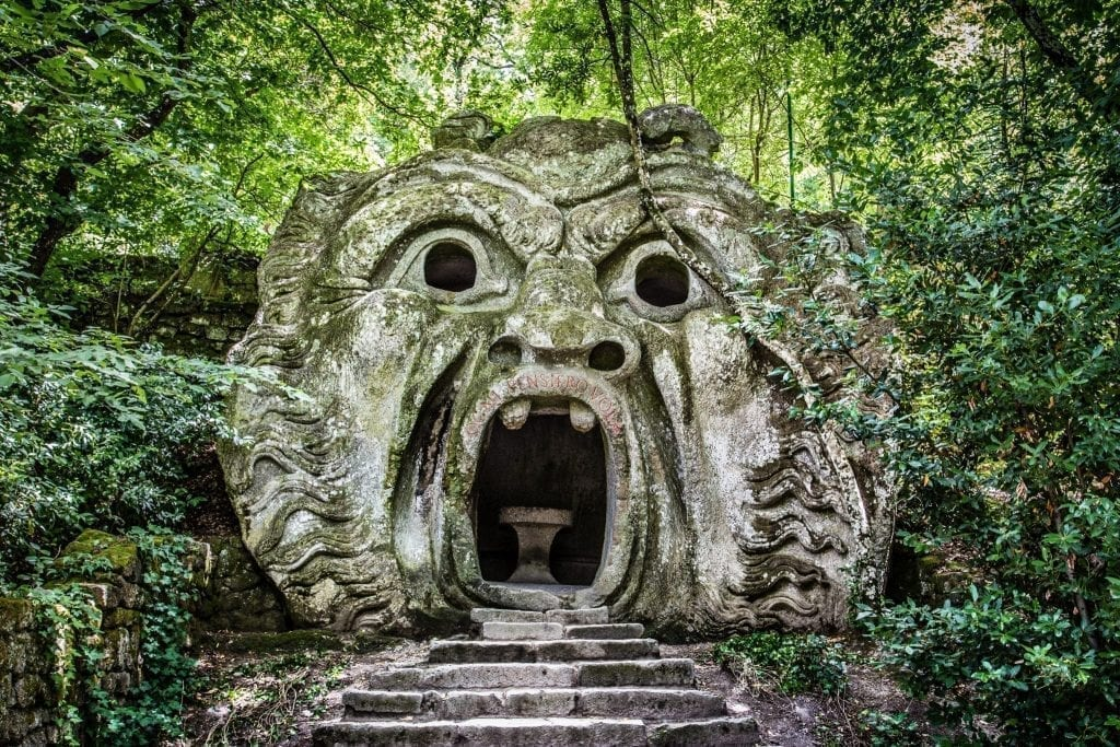 Monster entranceway in Bomarzo Park of Monsters in Lazio. Bomarzo is one of the most unique day trips from Rome Italy