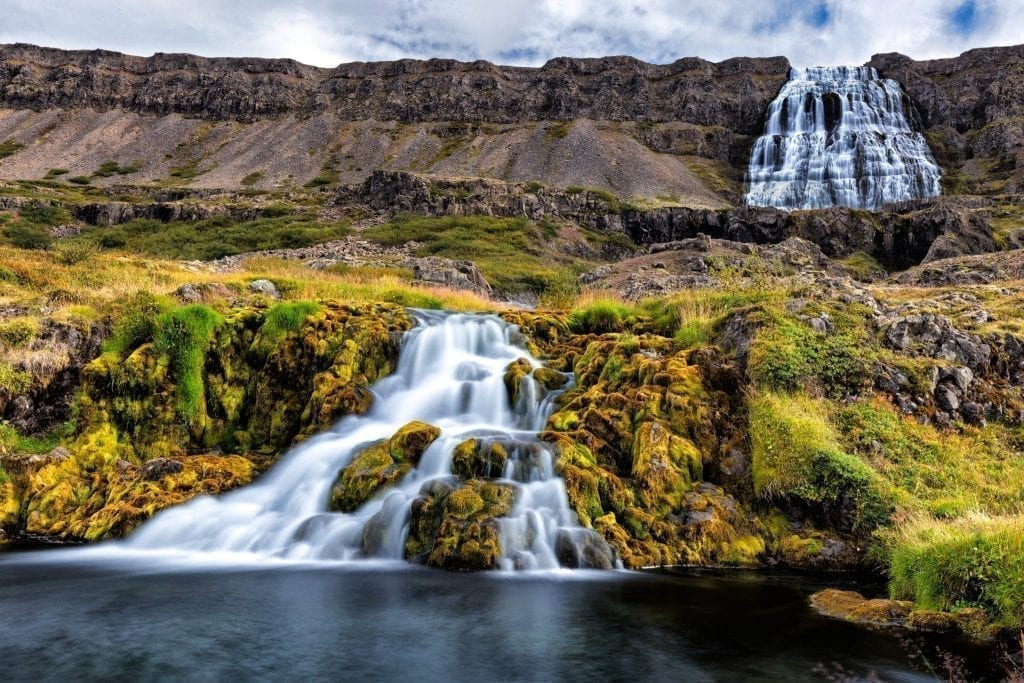 Dynjandi waterfall in the westfjords of Iceland, one of the best offbeat road trips in Europe