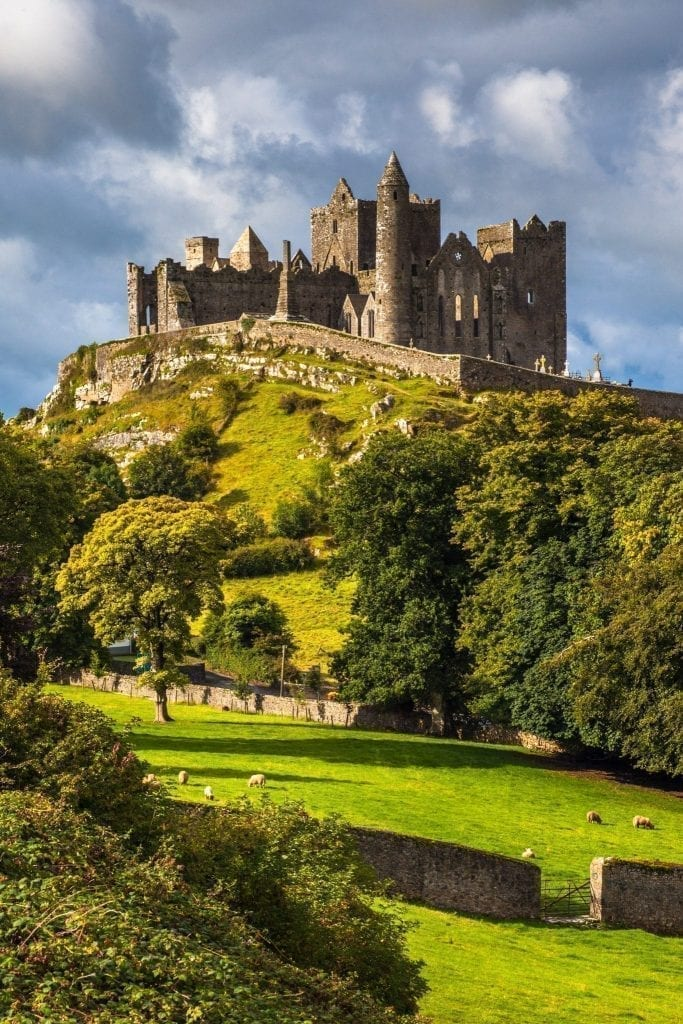 Rock of Cashel in Ireland as seen from across a pasture.