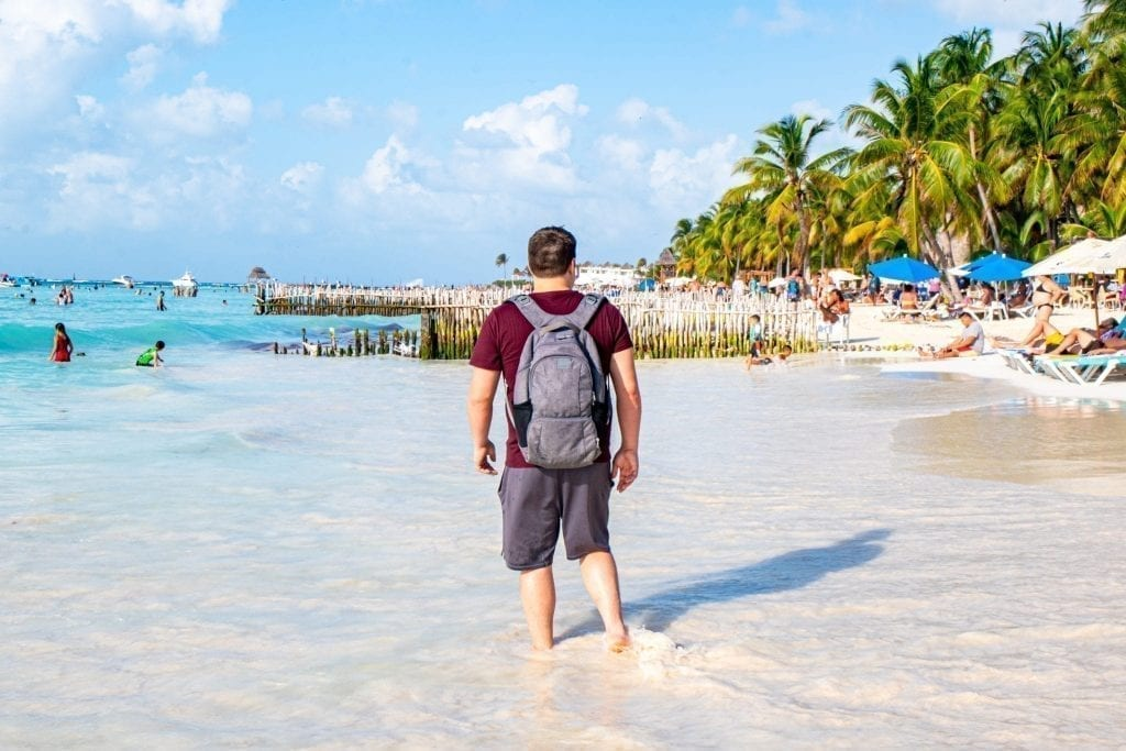 Jeremy Storm wearing Pacsafe antitheft backpack on Isla Mujeres Mexico
