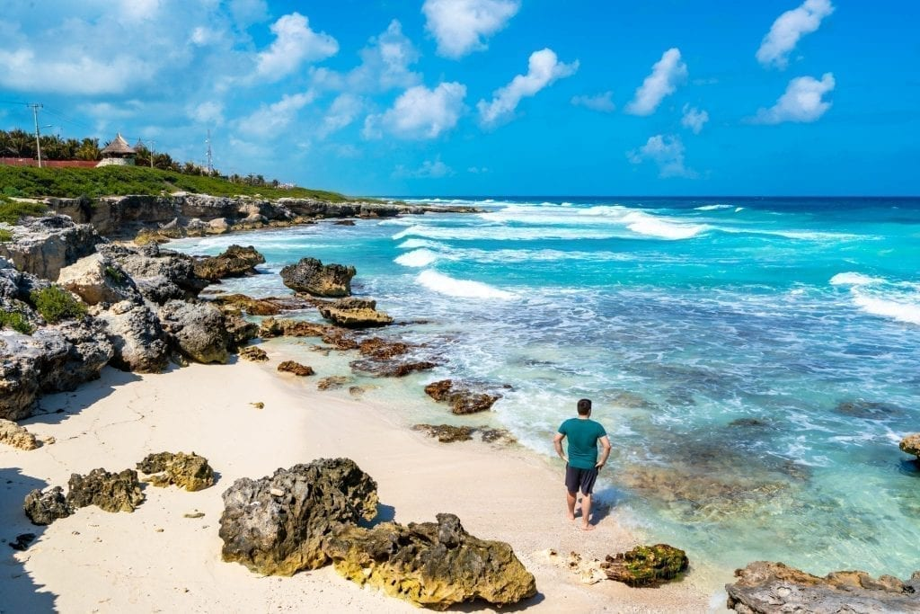 Jeremy Storm on the rocky beach of Isla Mujeres east coast