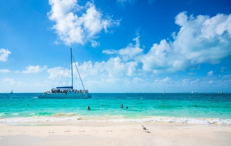 Catamaran offshore near Isla Mujeres Mexico--a catamaran tour to Isla Mujeres makes a fun day trip from Cancun