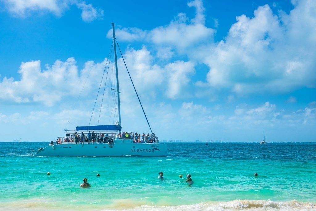 Catamaran full of tour goers offshore near Isla Mujeres Mexico