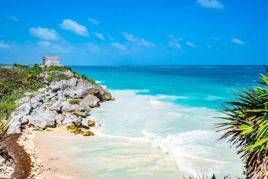 Tulum ruins overlooking a bright beach, as seen as part of a 10 day Yucatan itinerary