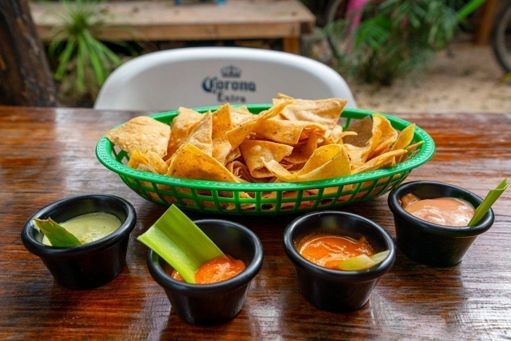 Tortilla chips and a selection of salsas as seen when traveling in Mexico travel tips