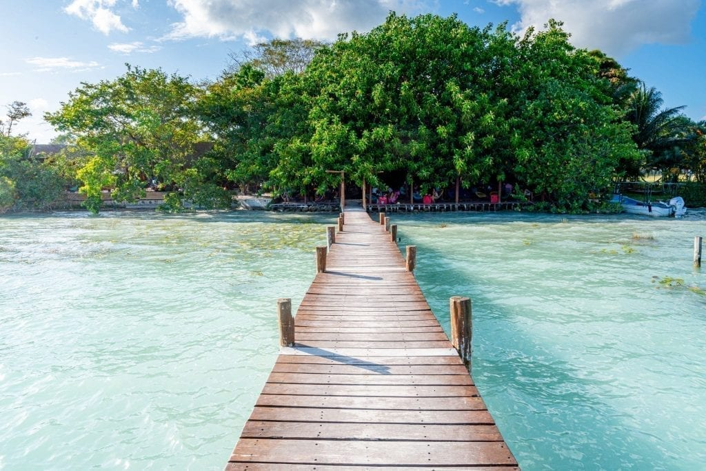 Dock in Bacalar Mexico as seen leading back to La Playita restaurant on a road trip Yucatan itinerary