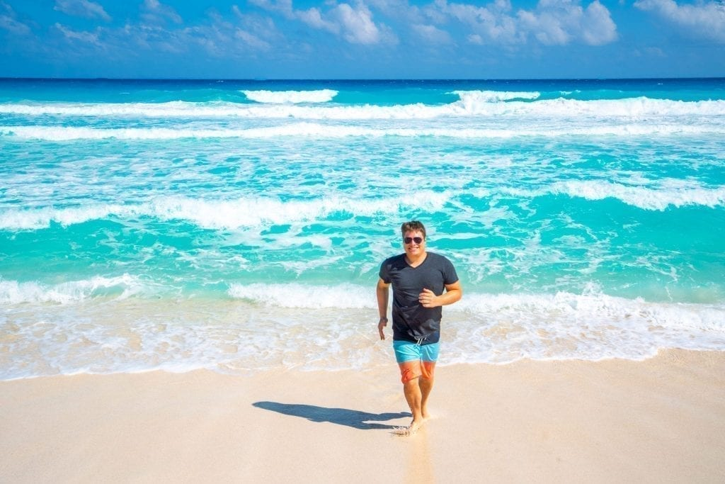 Jeremy Storm on Playa Delfines in Cancun on a sunny day during a road trip Yucatan
