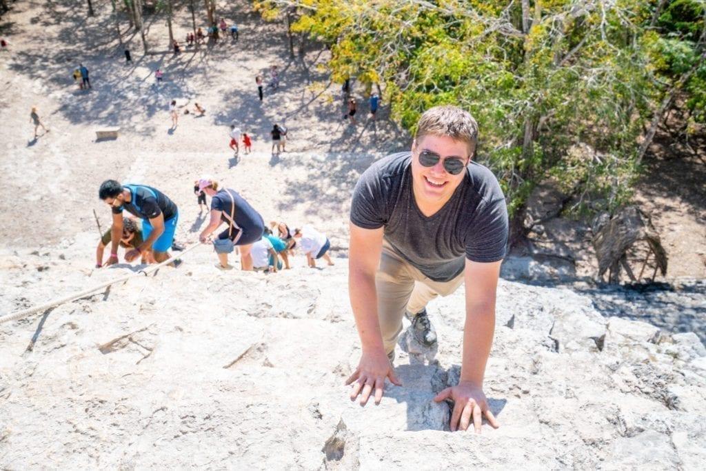 Jeremy Storm climbing Coba ruins pyramind on a road trip Yucatan itinerary