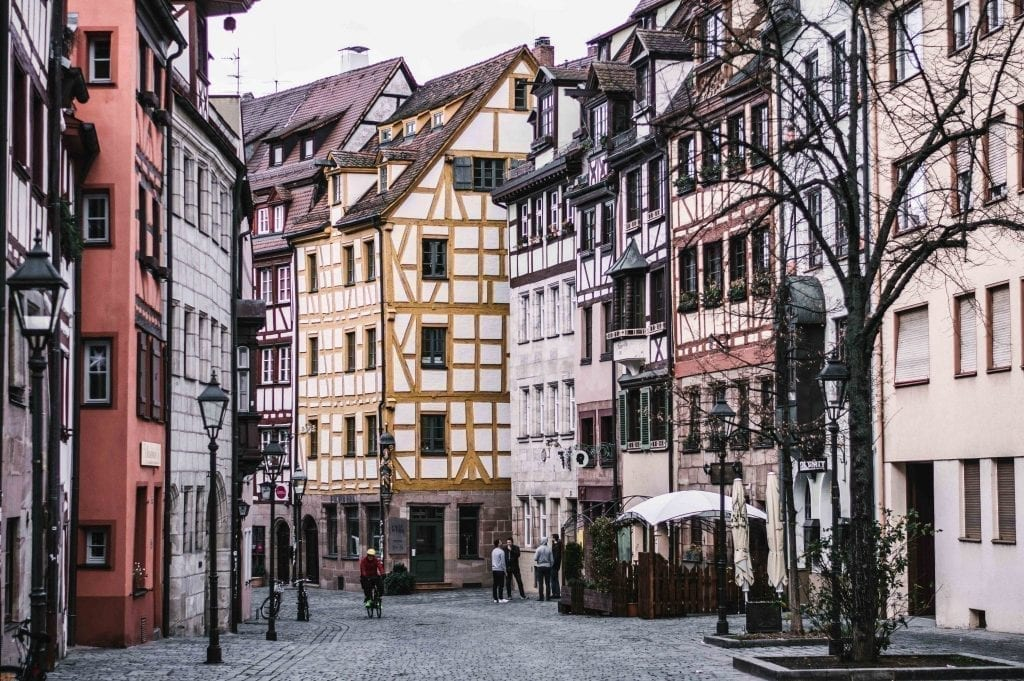 Colorful half-timbered houses on a quiet street in Nuremberg Germany