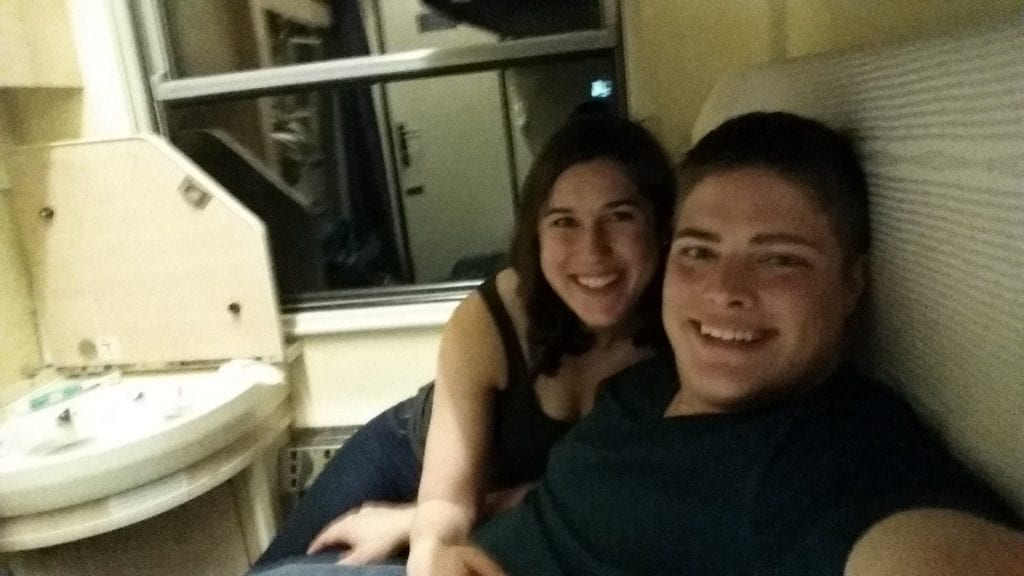 Kate Storm and Jeremy Storm selfie on a sleeper train through Europe