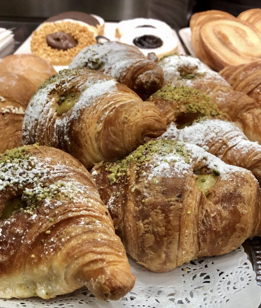 Pile of Italian breakfast pastries as seen when ordering coffee in Italy
