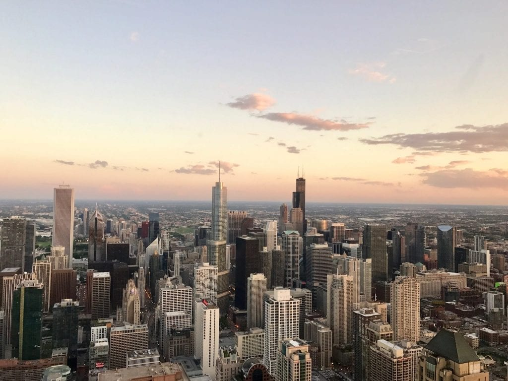 Chicago Skyline at sunset--views like this are plentiful throughout this 3 day Chicago itinerary!