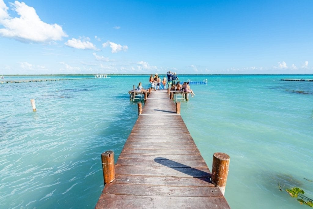 Dock at Bacalar Lagoon leading into the water, as seen on a road trip Yucatan travel itinerary