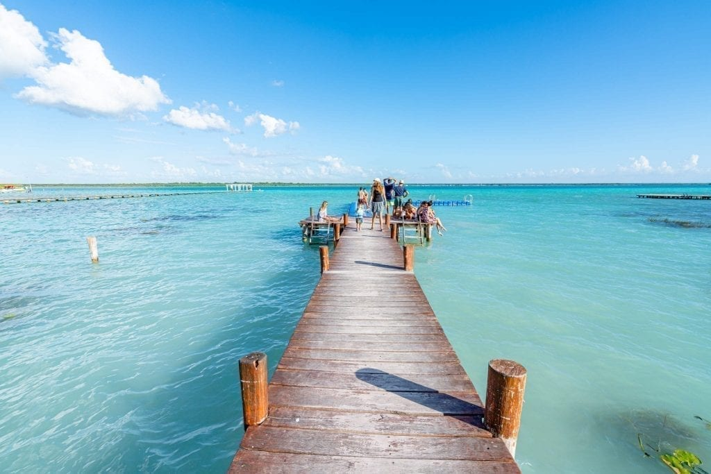 dock at bacalar lagoon leading into the water, a fantastic place to visit when backpacking mexico