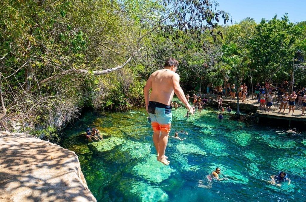 Jeremy Storm jumping into Cenote Azul Playa del Carmen