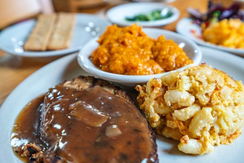 Close up of meatloaf, mac n cheese and sweet potatoes, classic lowcountry foods