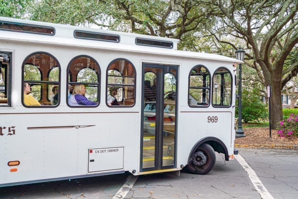 White trolley driving through Savannah GA