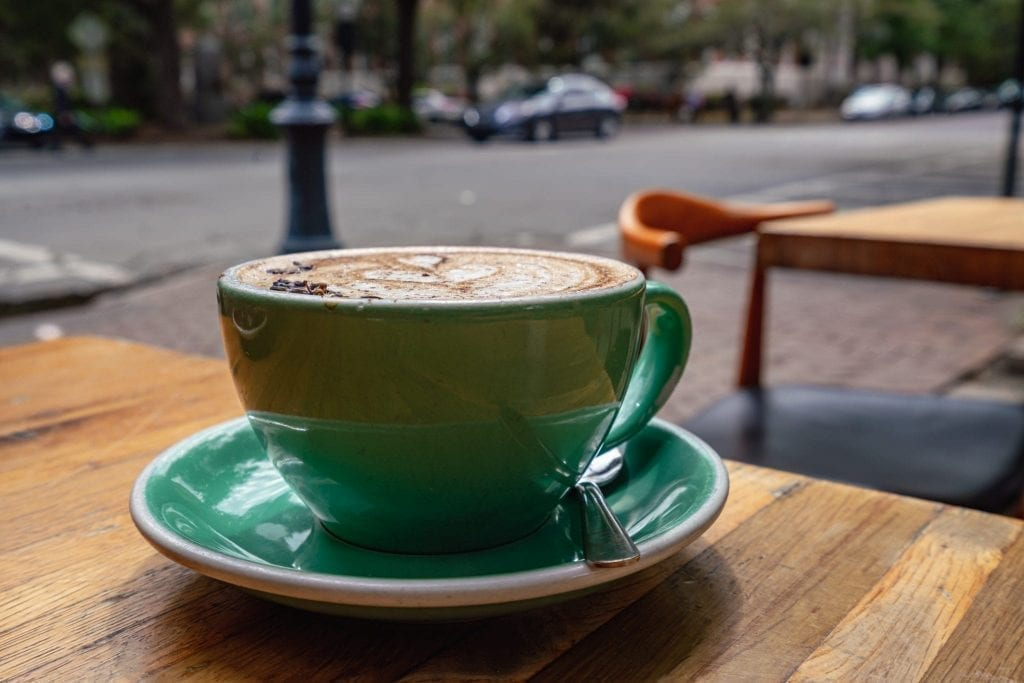 Spiced lavender mocha in a teal mug as served at the Collins Quarter, one of the best places to eat in Savannah in 3 days!