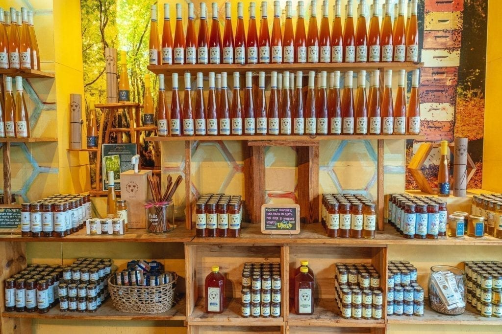 Interior of Savannah Bee Company showing multiple shelves of honey for sale