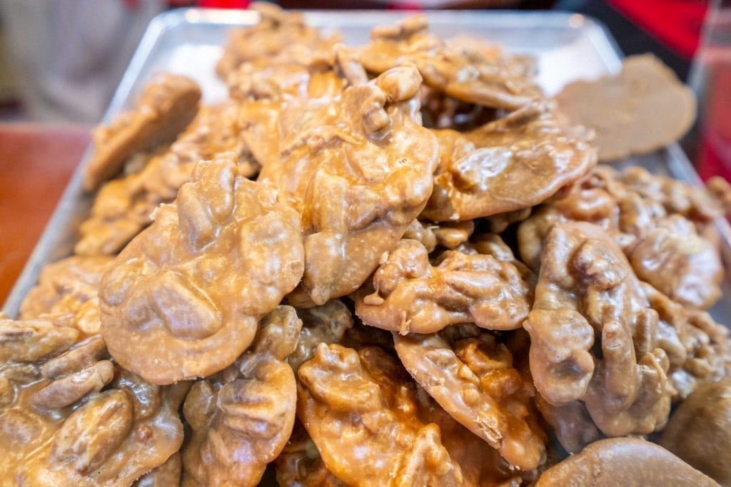Plate of pralines piled up in River Street Sweets, one of the best places to eat in Savannah Georgia