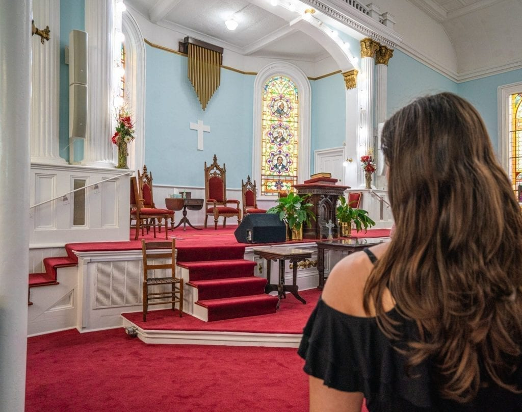Light blue altar of First African Baptist Church in Savannah GA with a woman's head on the right side of the photo