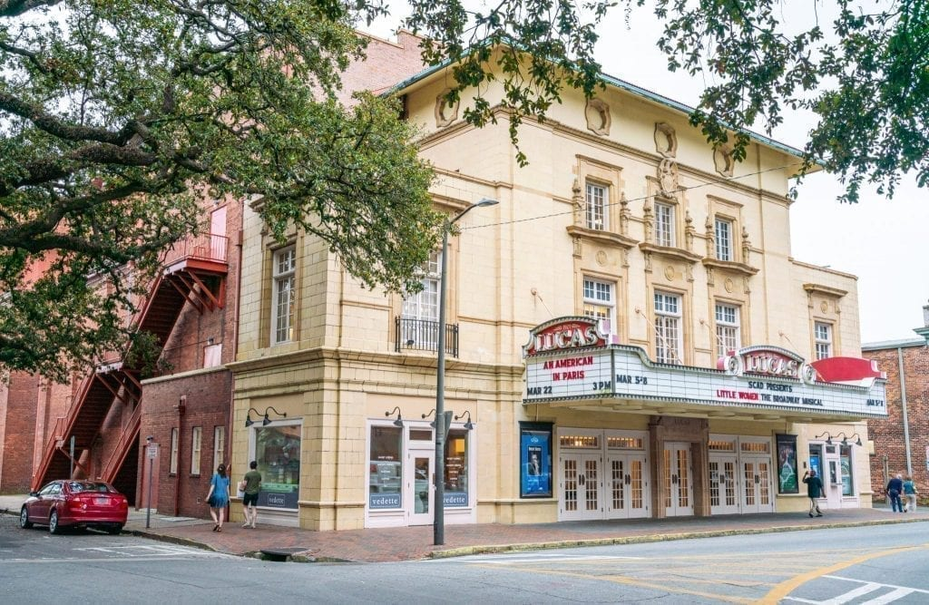 Lucas Theater in Savannah GA with trees from oak trees in the forgeround
