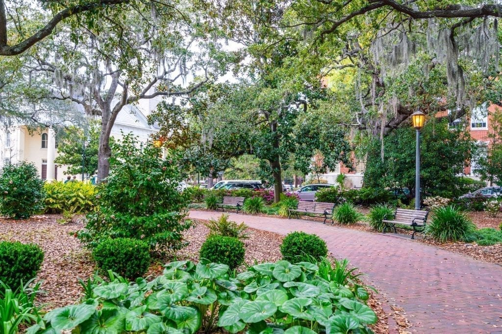 Shaded red path in Chippewa Square, an essential stop on a Savannah weekend getaway