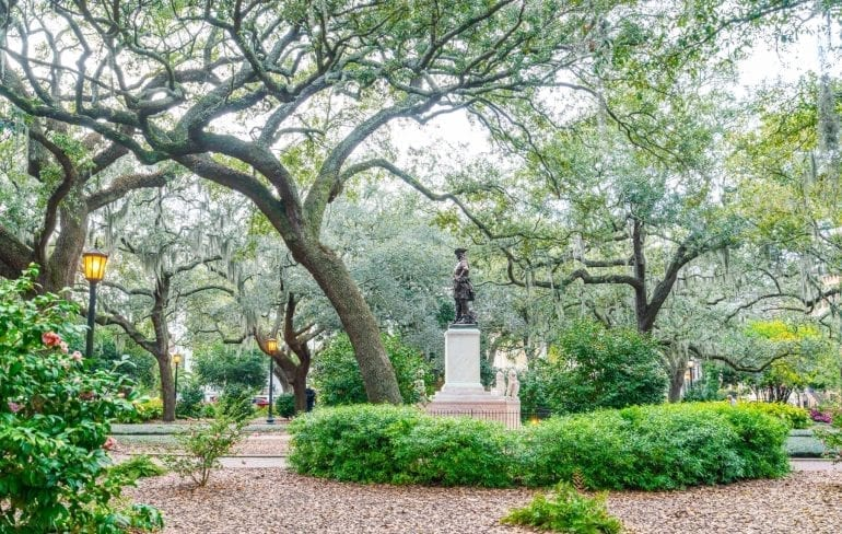City square in Savannah GA with a statue in the center--these city squares should be considered when choosing Savannah or Charleston