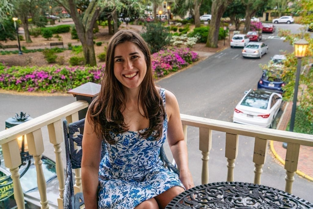 Kate Storm sitting on a balcony overlooking Chippewa Square at Foley House Inn during a long weekend in Savannah GA