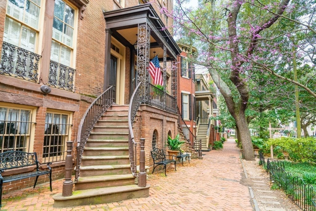 Curved staircase in front of a beautiful home on Jones Street Savannah GA. This street is an essential stop on a long weekend in Savannah travel guide!
